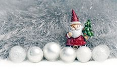 Christmas decoration on tinsel background. Santa claus andchristmas ball ornament  decoration on tinsel background Royalty Free Stock Photos