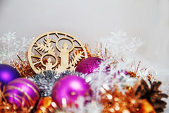 Christmas decoration. Of tinsel, Christmas balls, snowflakes, beads and bells and a wooden shaped candles Royalty Free Stock Photo