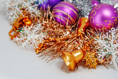 Christmas decoration. Of tinsel, Christmas balls, snowflakes, beads and bells and a wooden shaped candles Royalty Free Stock Photos