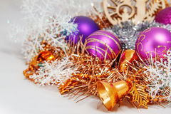 Christmas decoration. Of tinsel, Christmas balls, snowflakes, beads and bells and a wooden shaped candles Stock Images