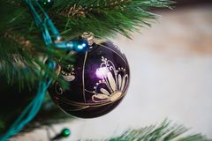Refined and sophisticated Christmas decoration toy ball. Christmas decoration toy ball with refined and sophisticated painted pattern hanging on Christmas tree royalty free stock photos