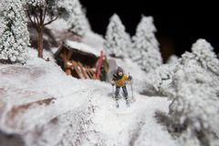 Christmas decoration toy decoration man man skiing on white snow in winter in the mountains ski poles against the background of co Royalty Free Stock Image