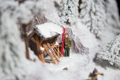 Christmas decoration toy decoration man man skiing on white snow in winter in the mountains ski poles against the background of co Stock Photos