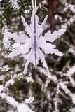 Christmas decoration with a toy in the shape of silver snowflake, selective focus. Image with copy space. stock images