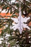 Christmas decoration with a toy in the shape of silver snowflake, selective focus. Image with copy space. royalty free stock photos