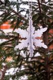 Christmas decoration with a toy in the shape of silver snowflake, selective focus. Image with copy space. Christmas postcard stock photography