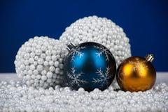 Christmas decoration toys on snow royalty free stock image