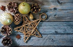 Christmas decoration toys, star, pine, cone, stick of cinnamon and anise royalty free stock images