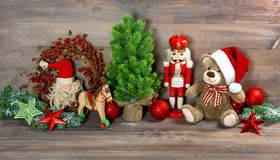 Christmas decoration with toys teddy bear and nutcracker Royalty Free Stock Images
