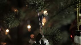 Christmas decoration on tree with bokeh lights.  stock video footage