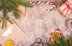 Christmas decoration with a tree, chic, gingerbread man, gift, envelope, candy cane and scissors. Preparing for Christmas. Gift wr royalty free stock photo