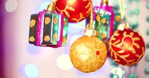 Christmas decoration on tree with Christmas lights. Decoration on a Christmas tree with a ball, bows, asterisks and. Festive Christmas and New Year Decoration stock footage