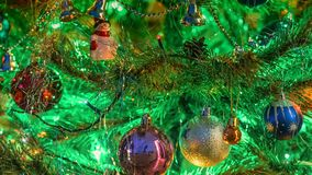 Christmas decoration on a tree. Christmas tree, decoration and lights at nights Stock Photo