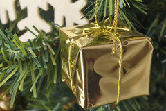 Christmas decoration tree detail with golden gift Stock Image