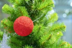 Christmas decoration on the tree in the form of a red ball of yarn royalty free stock photos