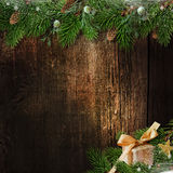 Christmas decoration with tree and gift-box on grunge wood. Christmas decoration with fir-tree and gift on grunge wood background. with place for photo and text Stock Image