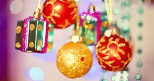 Christmas decoration on tree with Christmas lights. Decoration on a Christmas tree with a ball, bows, asterisks and. Festive Christmas and New Year Decoration stock video footage