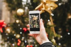 Christmas decoration on tree, picture by phone Stock Photos