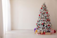 Christmas decoration Christmas tree with presents in white. 1 Royalty Free Stock Photography
