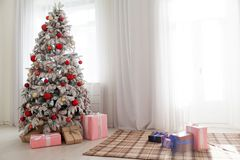 Christmas decoration Christmas tree with presents in white. 1 Stock Photography