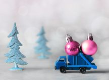 Christmas decoration. Truck car carries decorations for Christmas trees. Christmas ball Royalty Free Stock Photography