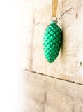 Christmas decoration, turquoise  pine cone  hanging on a wooden Royalty Free Stock Photography