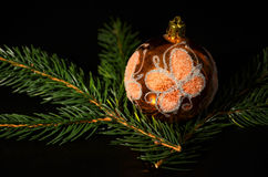 Christmas decoration with twig of spruce. On the black background Royalty Free Stock Image