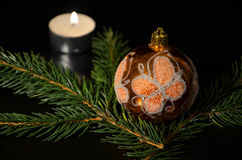 Christmas decoration with twig of spruce. On the black background Royalty Free Stock Photography