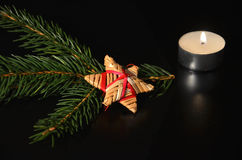 Christmas decoration with twig of spruce. On the black background Stock Photo