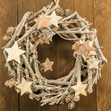 Christmas decoration with twigs, brown pine cone and wooden star Stock Images