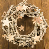 Christmas decoration with twigs, brown pine cone and wooden star Royalty Free Stock Image