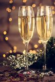 Christmas decoration with two glasses of champagne Royalty Free Stock Images