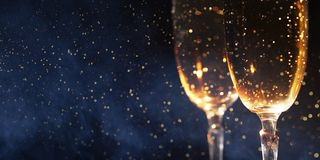 Christmas decoration with two glasses of champagne and lights on a wooden background, Happy New Year. royalty free stock photos