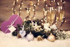 Christmas decoration with two glasses of champagne Royalty Free Stock Photography