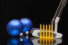 Christmas decoration and two golf putters Stock Photography