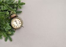 Christmas decoration vintage alarm clock grey background. Christmas decoration vintage alarm clock on grey background Royalty Free Stock Images