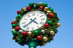 Christmas decoration on vintage clock Royalty Free Stock Photography