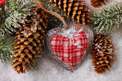 Christmas decoration with vintage heart on snow Royalty Free Stock Photos