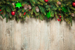 Christmas decoration. Vintage christmas decoration over old wooden background Stock Photo