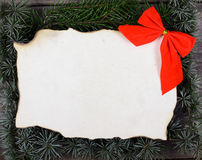 Christmas decoration and vintage paper on wooden background Royalty Free Stock Photography