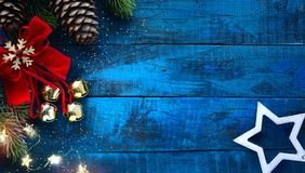 Christmas decoration in vintage style at old blue wooden board stock images