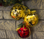 Christmas decoration on the wall of gold and red bells Royalty Free Stock Photos