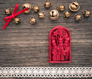 Christmas decoration of wax, the three Magi, bells, lace on wood Stock Photos