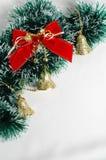 Christmas decoration on white background. Handbells a red sphere and a bow Christmas decoration on white background Stock Image