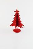 Christmas decoration on white background. Little, red metallic christmas tree on white background Stock Photo