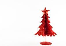 Christmas decoration on white background. Little, red metallic christmas tree on white background Stock Photography