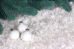 Christmas decoration with white chrismas ball snow and fir branches. Christmas decoration with white chrismas ball snow and fir branches Royalty Free Stock Photo