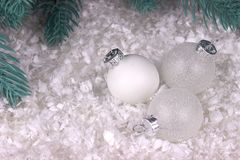Christmas decoration with white chrismas ball snow and fir branches. Christmas decoration with white chrismas ball snow and fir branches Royalty Free Stock Images