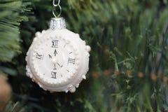 Christmas decoration white clock. On christmas tree Stock Photography