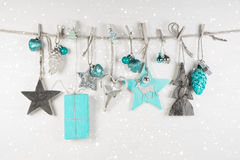 Christmas decoration in white an light blue on wooden background Royalty Free Stock Photos
